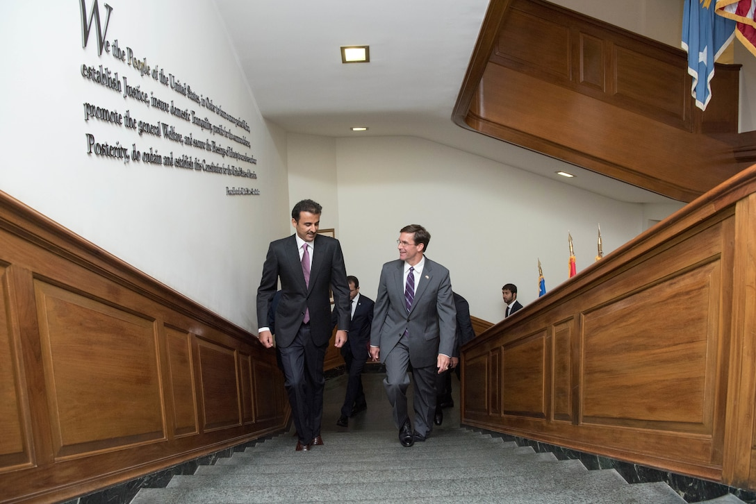 Acting Defense Secretary Dr. Mark T. Esper walks up stairs with another man.