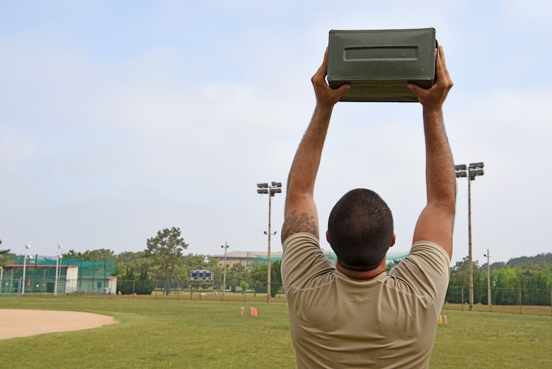 Staff Sgt. Richard Gardner, 8th Security Forces Squadron 2019 Advanced Combat Skills Assessment team member, lifts an ammo can during physical training at Kunsan Air Base, Republic of Korea, June 5, 2019. Team Kunsan not only brought home the top team trophy, they also placed first in three of the five events, including the mental and physical challenge, combat weapons and the combat fitness challenge. (U.S. Air Force photo by Staff Sgt. Mackenzie Mendez)