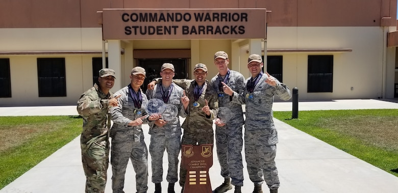 The 8th Security Forces Squadron 2019 Advanced Combat Skills Assessment team celebrate their victory following the weeklong competition at Andersen Air Force Base, Guam, June 28, 2019. The 8th SFS team competed against 10 teams of PACAF's top defenders in numerous events that challenged the defenders' mental and physical fortitude including hand-to-hand combatives, marksmanship, range estimation, physical fitness, land navigation and building clearing tactics. (Courtesy Photo)