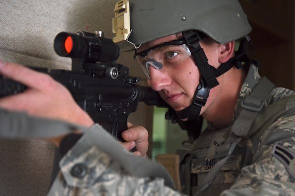 Airman 1st Class Cornelis Mol, 8th Security Forces Squadron 2019 Advanced Combat Skills Assessment team member, trains on clearing and breaching buildings at Kunsan Air Base, Republic of Korea, June 3, 2019. The five-person team trained for a month prior to traveling to Andersen Air Base, Guam, for the weeklong competition. (U.S. Air Force photo by Staff Sgt. Mackenzie Mendez)