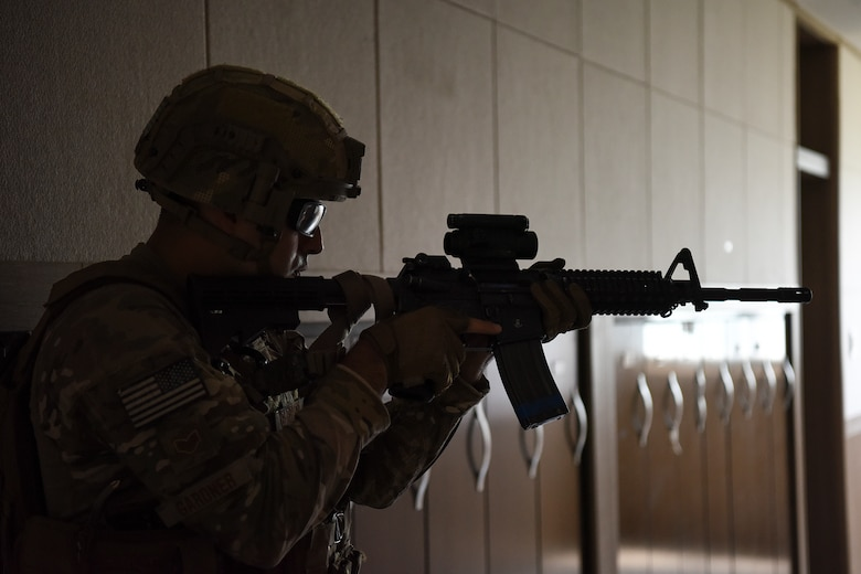 Staff Sgt. Richard Gardner, 8th Security Forces Squadron 2019 Advanced Combat Skills Assessment team member, trains on clearing and breaching buildings at Kunsan Air Base, Republic of Korea, June 3, 2019. The ACSA competition challenges security forces members with hand-to-hand combatives, marksmanship, range estimation, physical fitness, land navigation and building clearing tactics. (U.S. Air Force photo by Staff Sgt. Mackenzie Mendez)
