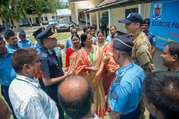 Bangladesh Air Force Maj. Gen. M. Nazoul Islam, center left, commanding officer of BAF Base Matiur Rahman, and U.S. Air Force Maj. Kristoffer Palmer, center right, Pacific Angel 19-1 mission commander, speak with teachers after celebrating the opening ceremony of Pacific Angel 19-1 at Kazir Chowra Bilateral High School in Lalmonirhat, Bangladesh, June 23, 2019. Pacific Angel 2019 is a joint and combined humanitarian assistance engagement, enhancing participating nations' humanitarian assistance and disaster relief capabilities while providing beneficial services to people in need throughout South and Southeast Asia. (U.S. Air Force photo by 2nd Lt. Brigitte N. Brantley)