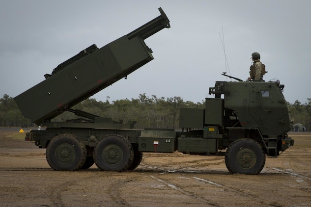 U.S. Marines assigned to 3rd Marine Division simulate preparing a High Mobility Artillery Rocket System (HIMARS) to fire during Exercise Talisman Saber 19 at Shoalwater Bay Training Area, July 6, 2019. In HIRAIN missions, HIMARS are flown in C-130s to an area, unloaded to rapidly conduct a fire missions, then reloaded in and relocated to follow on objectives. (U.S. Marine Corps photo by Lance Cpl. Kaleb Martin)