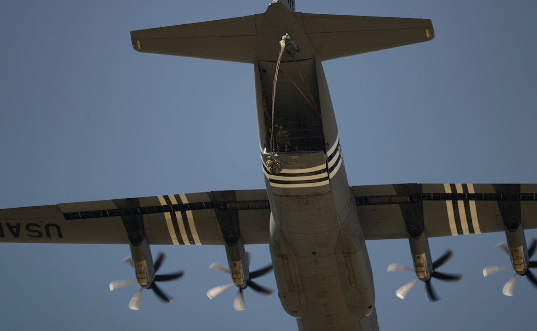 A parachutist jumps from a C-130 J Super Hercules aircraft over Ramstein Air Base, Germany, July 2, 2019. Approximately 40 paratroopers participated in the training, the first conducted over Ramstein since Nov. 2017.