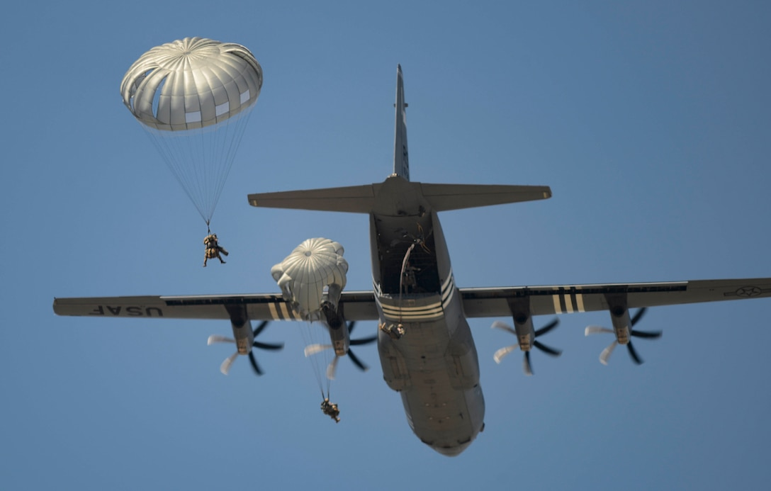 Parachutists assigned to the 435th Air Ground Operation Wing and the 16th Sustainment Brigade jump from a C-130 J Super Hercules aircraft over Ramstein Air Base, Germany, July 2, 2019. The jump allowed personnel to maintain proficiency on static line parachute operations so that they can be ready to support potential contingency operations in Europe.