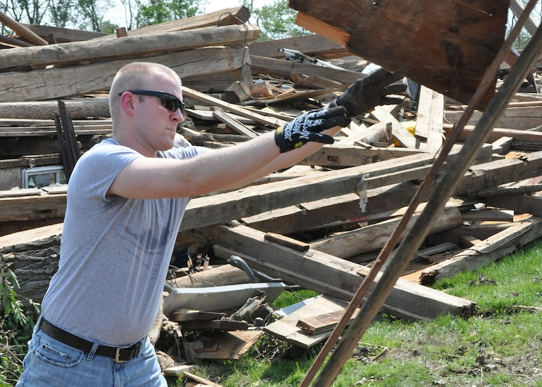 Tech. Sgt. Jonathan Porter, 445th Logistics Readiness Squadron, clears away debris while helping with disaster relief efforts June 1, 2019. Nearly a dozen Airmen from the 445th Airlift Wing living at Wright-Patterson Air Force Base and surrounding communities experienced damage to their property after tornados hit the area May 27, 2019.