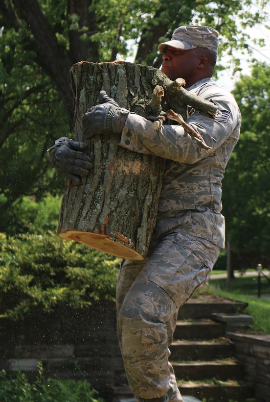 Tech. Sgt. Jason Thomas, 445th Aerospace Medicine Squadron medical technician, carries part of a tree that was cut into pieces as part of the tornado cleanup effort June 1, 2019. Nine Airmen from the 445th AMDS were helping one of their own who's home was heavily damaged after several tornadoes hit the Miami Valley area May 27, 2019