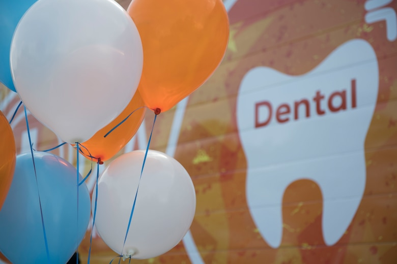 Balloons are set up to celebrate the grand opening of the Dentrust Optimized Care Solutions mobile treatment facility at Joint Base Langley-Eustis, Virginia, July 8, 2019.