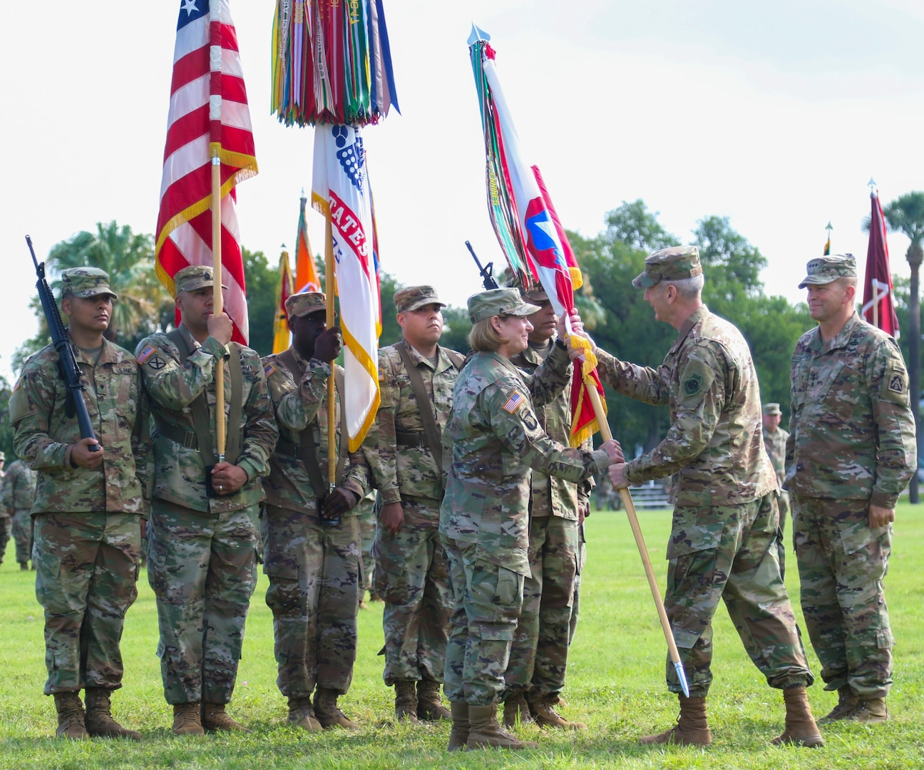 U.S. Army Lt. Gen. Laura J. Richardson, incoming U.S. Army North commander, accepts the Army North (Fifth Army) colors from U.S. Air Force Gen. Terrence J. O'Shaughnessy, commanding general, U.S. Northern Command, during the change of command ceremony at Joint Base San Antonio-Fort Sam Houston July 8. Richardson most recently served at U.S. Army Forces Command at Fort Bragg, North Carolina, where she was the deputy commanding general.