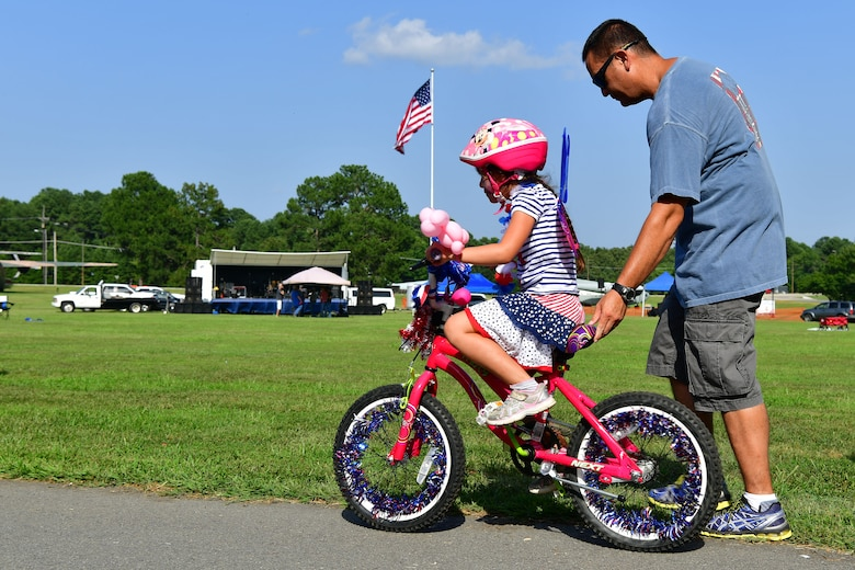 A child rides a bike at the Liberty Fest.