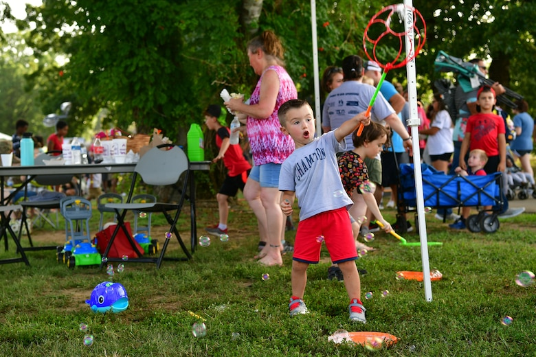 A child plays with bublbes during the Liberty Fest