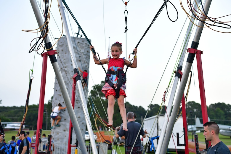 A child bounces on a bungee jumper.
