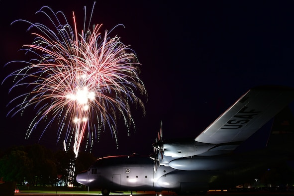 Fireworks go off over a C-130H during liberty fest