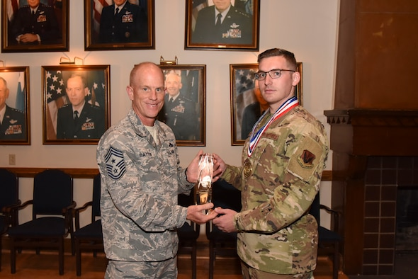 U.S. Air Force Staff Sgt. George Skon, 792nd Intelligence Support Squadron, is presented the Air Combat Command's 2018 Outstanding Airmen of the Year award by Chief Master Sgt. Frank Batten, former ACC command chief, during the 480th ISR Wing's annual award ceremony at Joint Base Langley-Eustis, May 29, 2019. The award is given to 12 enlisted Airmen who go above and beyond what their job entails, what others expect of them, and give fellow Airmen a blueprint of how to excel and embody the whole Airman concept. (U.S. Air Force photo by Tech. Sgt. Darnell Cannady)