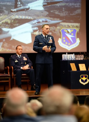 Retired Brig. Gen. John Cherrey, former Director of Intelligence, Operations and Nuclear Integration, Headquarters Air Education and Training Command at Joint Base San Antonio-Randolph, speaks to attendees during Specialized Undergraduate Pilot Training Class's 19-17/18 graduation in the Kaye Auditorium June 28 at Columbus Air Force Base, Mississippi. Cherrey spoke about his last 30 years as a pilot and wanted the newest generation of aviators to understand how important their job is.