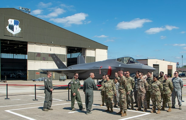 U.S. Air Force Gen. Jeffrey L. Harrigian, U.S. Air Forces in Europe - Air Forces Africa commander meets with service members assigned to 421st Fighter Squadron, Hill Air Force Base, Utah, on temporary duty assignment at Spangdahlem Air Base, Germany, July 3, 2019. The 421st FS is flying F-35A Lighting II on training missions with F-16 Fighting Falcons from the 52nd Fighter Wing. (U.S. Air Force photo by Airman 1st Class Kyle Cope)