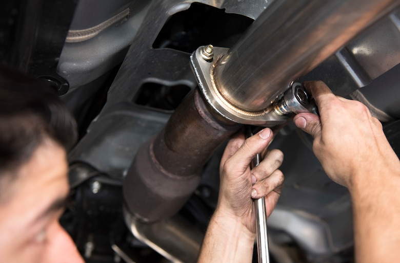 Senior Airman Igor Pacheco, 56th Medical Support Squadron lab technician, uses a ratchet to loosen a bolt on an exhaust system's middle piping June 29, 2019, at the Auto Hobby Shop at Luke Air Force Base, Ariz.