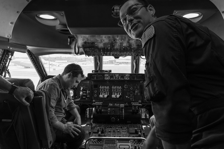 Director Oliver Butler with the Arts in the Armed Forces, looks over the controls in the cockpit of a C-5M Super Galaxy during a tour of the 433rd Airlift Wing, Joint Base San Antonio-Lackland, Texas, June 28, 2019.
