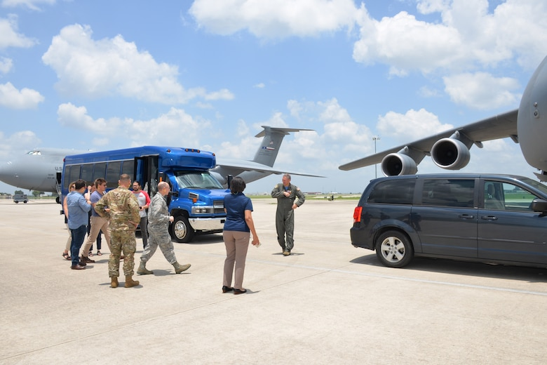 Actors and support staff from the Arts in the Armed Forces head toward a C-5M Super Galaxy, June 28, 2019, at Joint Base San Antonio-Lackland, Texas, for a tour of the massive aircraft.