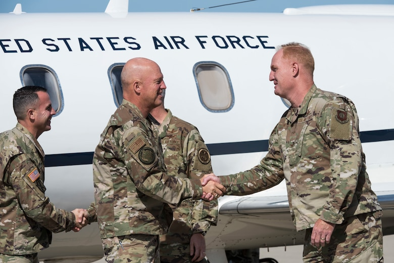 Gen. Jay Raymond, the commander of Air Force Space Command and the Joint Force Space Component Command, is greeted by Col. Michael Hough, 30th Space Wing commander, July 2, 2019, at Vandenberg Air Force Base, Calif. During his visit, Raymond toured units across the base and held an all-call to discuss the future of space warfighters. (U.S. Air Force photo by Airman 1st Class Aubree Milks)