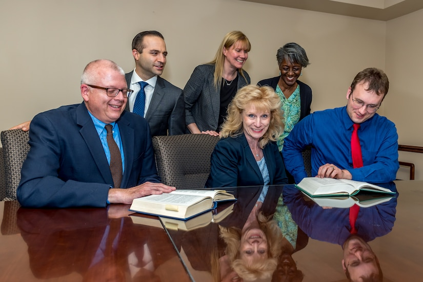 Photo of Marti Verbonitz with the Tobyhanna Army Depot legal team