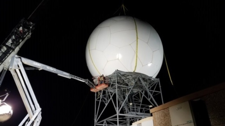 Contractors with Telecommunication Support Services Solutions, Inc., based in Florida, install a radome on a Weather Surveillance Doppler radar overnight Feb. 17, at Cannon Air Force Base, New Mexico. The company is on contract as part Program Executive Office Digital's effort to support and sustain 25 radars owned by the U.S. Air Force. These 25 radars are one portion of more than 180 U.S. government-owned radars, called the NEXRAD system, which provides weather forecasts to the military, Federal Aviation Administration and National Weather Service. (Photo courtesy of Telecommunication Support Services Solutions)