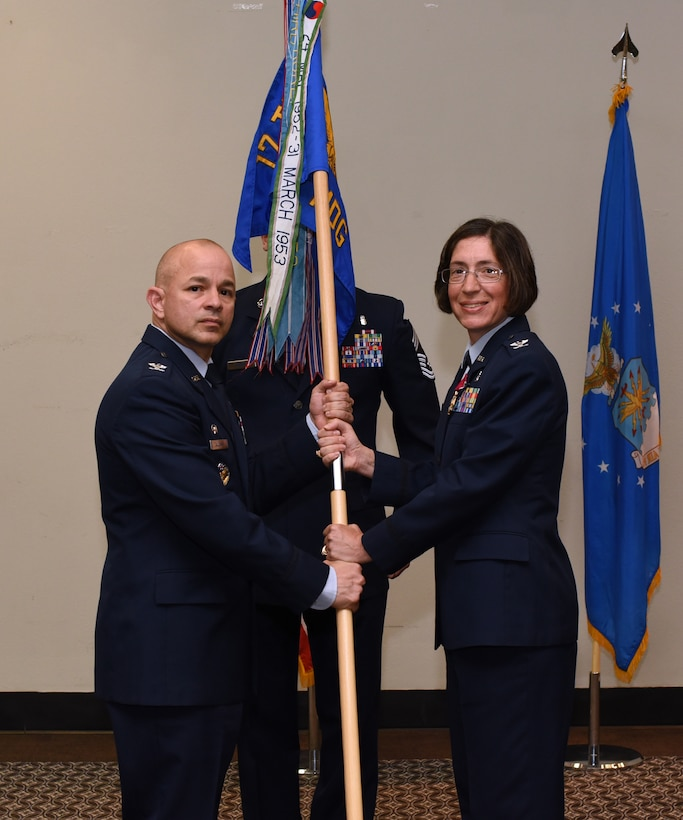 U.S. Air Force Col. Janet Urbanski, 17th Medical Group outgoing commander, formally relinquishes her command by handing Col. Andres Nazario, 17th Training Wing commander, her guidon during the 17th MDG Change of Command Ceremony held at the event center on Goodfellow Air Force Base, Texas, July 8, 2019.  Urbanski led over 200 military, civilian and contract employees to serve thousands of beneficiaries and students in healthcare missions during her two years of service at Goodfellow. (U.S. Air Force photo by Airman 1st Class Abbey Rieves/Released)