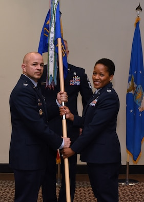 U.S. Air Force Col. Andres Nazario, 17th Training Wing commander, formally hands command to Col. Lauren Byrd, 17th Medical Group incoming commander, during the 17th MDG Change of Command Ceremony held at the event center on Goodfellow Air Force Base, Texas, July 8, 2019. Byrd was the 11th Medical Group Administrator at Joint Base Andrews, Maryland, prior to her current assignment at Goodfellow. (U.S. Air Force photo by Airman 1st Class Abbey Rieves/Released)