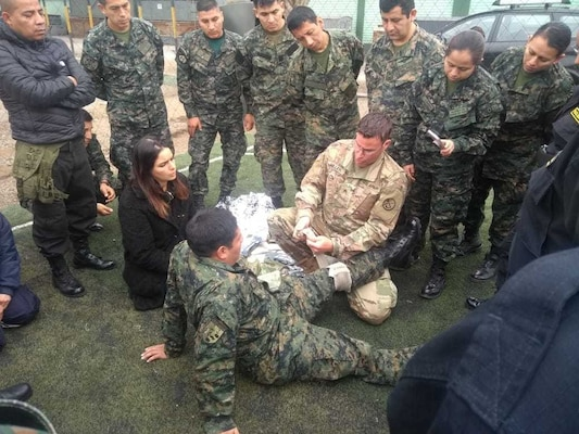Sgt. Brad Miller, a medical readiness non-commissioned officer with the West Virginia Army National Guard (WVARNG) medical detachment, provides training on tactical casualty combat care (TCCC) to members of the Peruvian Armed Forces during a hands-on training held July 2, 2019, in Lima, Peru. Members of the WVARNG trained more than 120 members of the Peruvian Armed Forces and the Peruvian National Police on a variety of aeromedical topics during a week-long subject matter exchange. (Courtesy photo)