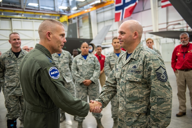 U.S. Air Force Lt. Gen. Steven Kwast, commander of Air Education and Training Command, meets with an Airman assigned to the 56th Fighter Wing at Luke Air Force Base, Arizona during a visit July 20, 2018.  Kwast, a U.S. Air Force Academy graduate, will pass command of AETC to Lt. Gen. Brad Webb July 26, 2019. (U.S. Air Force photo / Courtesy)