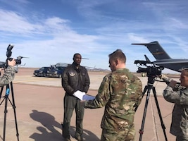 Maj. Jon Quinlan (right center) conducts a video interview for the 507th Air Refueling Wing public affairs office prior to a KC-46A arrival ceremony, Feb. 8, 2019.  Quinlan served as the chief of public affairs for the 507 ARW from Nov. 2012 to July 2019.  (U.S. Air Force Photo by Lauren Gleason)