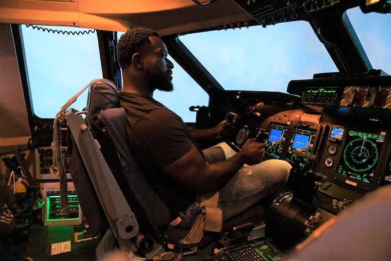 Actor, Michael James Shaw sits in the cockpit of a C-5M Simulator during a tour of the 433rd Airlift Wing, Joint Base San Antonio, Texas June 28, 2019.