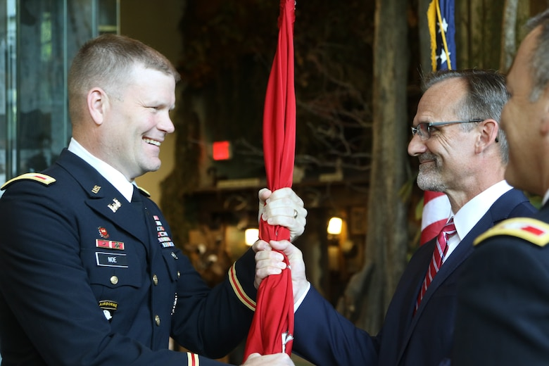 Col. Eric Noe (right) returns the Army Corps of Engineers flag to Craig Pierce, Deputy District Engineer for programs and project management of the Corps' Little Rock District, during the district change of command ceremony.