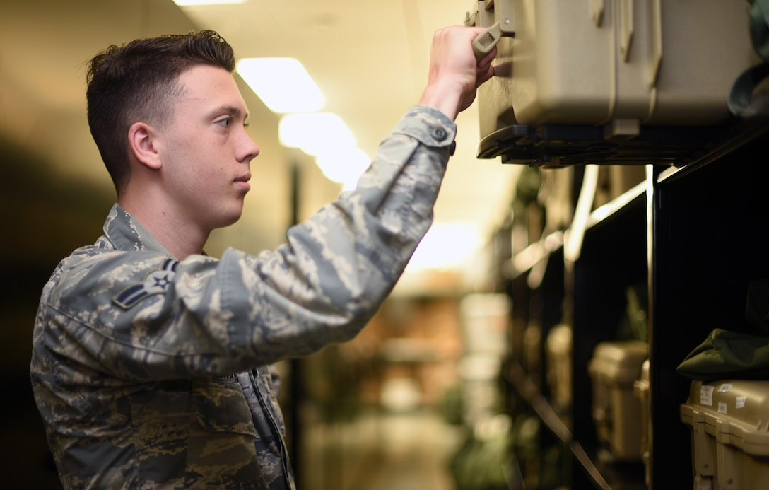 U.S. Air Force Airman 1st Class Caleb Kavanaugh, 60th Operations Support Squadron Aircrew Flight Equipment technician, inspects aircrew equipment July 9, 2019, at Travis Air Force Base, California. Travis' AFE flight works to keep aircrew flight equipment in good working condition thereby safeguarding aircrew personnel in the event of dangerous situations. (U.S. Air Force photo by Senior Airman Christian Conrad)