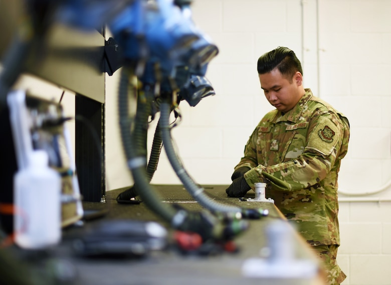 U.S. Air Force Staff Sgt. Kenny Pham, 60th Operations Support Squadron Aircrew Flight Equipment technician, inspects aircrew flight equipment July 9, 2019, at Travis Air Force Base, California. Travis' AFE flight works to keep aircrew flight equipment in good working condition thereby safeguarding aircrew personnel in the event of dangerous situations. (U.S. Air Force photo by Senior Airman Christian Conrad)