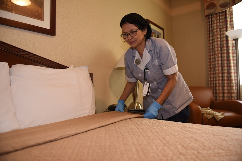 Cecilia Tiana, Westwind Inn housekeeper, gets a room ready for the next guest July 8, 2019, at Travis Air Force Base, California. Westwind Inn is one of the finalists for the Air Force's 2019 Innkeeper Award after being named the best in Air Mobility Command. The Innkeeper Award is an annual honor recognizing excellence in the service's lodging operations. (U.S. Air Force photo by Airman 1st Class Cameron Otte)