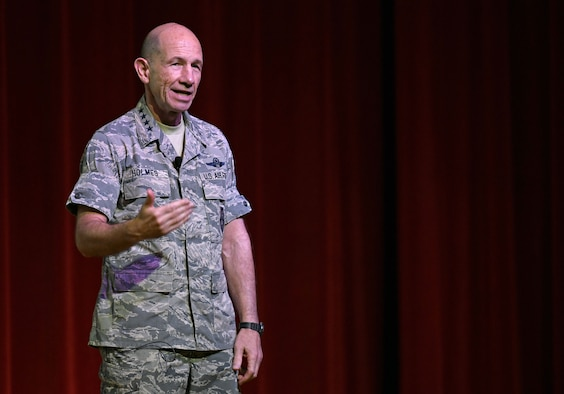 Photo of Gen. Mike Holmes, commander of Air Combat Command, discussing future 24th/25th Air Force merger at a town hall meeting.