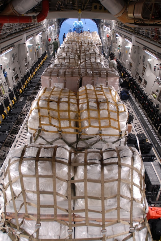A McChord C-17 Globemaster III transports humanitarian aid supplies to American Samoa after a tsunami hit the island, September, 2009.