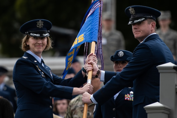 U.S. Air Force Col. Stephanie Kelley, 517th Training Group commander, accepts the guidon from Lt. Col. Brian McCreary, 311th Training Squadron outgoing commander, during the change of command ceremony on Soldier Field, Presidio of Monterey, California, July 8, 2019. McCreary increased the number of 311th TRS Airmen graduating from the Russian language program by 42 percent. (Courtesy Photo)