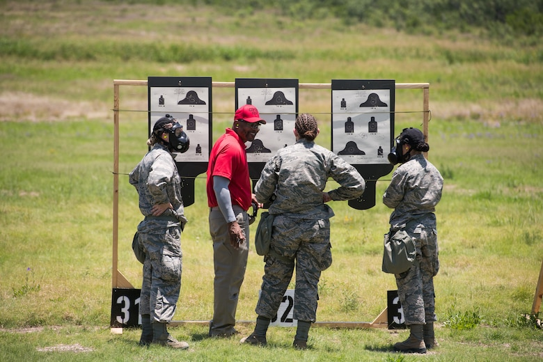 Mr. Nate Cade, 37th Training Support Squadron combat arms instructor, evaluates targets with BMT trainees during a weapons familiarization course, July 8, 2019, at Joint Base San Antonio-Medina Annex. BMT trainees were the first to experience M-4 Carbine Weapons Familiarization Course at the new facility, which closed in November 2018, due to improper rainwater drainage. The firing range allows instructors to train 244 BMT trainees daily, four days a week, qualifying more than 40,000 BMT trainees in the M-4 carbine annually. (U.S. Air Force photo by Sarayuth Pinthong)
