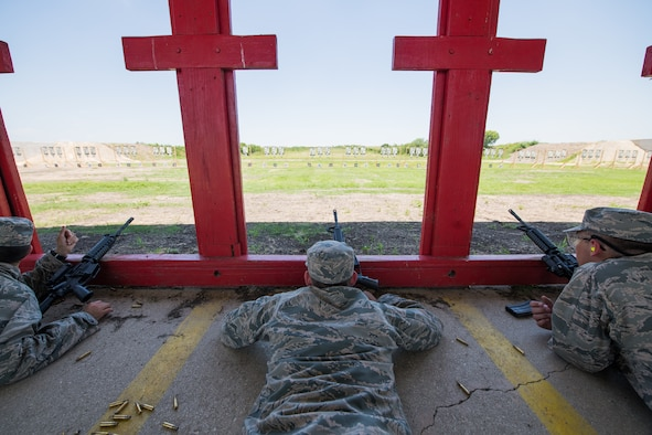 U.S. Air Force basic military training trainees prepare to engage targets during a weapons familiarization course, July 8, 2019, at Joint Base San Antonio-Medina Annex. BMT trainees were the first to experience M-4 Carbine Weapons Familiarization Course at the new facility, which closed in November 2018, due to improper rainwater drainage. The firing range allows instructors to train 244 BMT trainees daily, four days a week, qualifying more than 40,000 BMT trainees in the M-4 carbine annually. (U.S. Air Force photo by Sarayuth Pinthong)