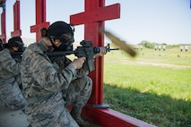 U.S. Air Force basic military training trainees fire their M-4 Carbine during a weapons familiarization course, June 8, 2019, at Joint Base San Antonio-Medina Annex. BMT trainees were the first to experience M-4 Carbine Weapons Familiarization Course at the new facility, which closed in November 2018, due to improper rainwater drainage. The firing range allows instructors to train 244 BMT trainees daily, four days a week, qualifying more than 40,000 BMT trainees in the M-4 carbine annually. (U.S. Air Force photo by Sarayuth Pinthong)