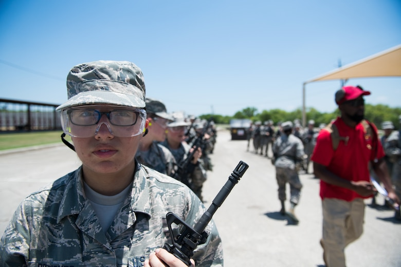 U.S. Air Force basic training trainees prepare to march back from the firing range after a weapons familiarization course, June 8, 2019, at Joint Base San Antonio-Medina Annex. BMT trainees were the first to experience M-4 Carbine Weapons Familiarization Course at the new facility, which closed in November 2018, due to improper rainwater drainage. The firing range allows instructors to train 244 BMT trainees daily, four days a week, qualifying more than 40,000 BMT trainees in the M-4 carbine annually. (U.S. Air Force photo by Sarayuth Pinthong)