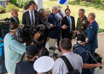 Marine Corps Gen. Joe Dunford, chairman of the Joint Chiefs of Staff, and Finnish Air Force Gen. Jarmo Lindberg, Finnish Chief of Defense, speak to media following an Armed Forces Full Honor Arrival Ceremony on Whipple Field at Joint Base Myer-Henderson Hall, July 9, 2019.