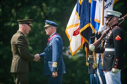 Marine Corps Gen. Joe Dunford, chairman of the Joint Chiefs of Staff, hosts an Armed Forces Full Honor Arrival Ceremony for Finnish Air Force Gen. Jarmo Lindberg, Finnish Chief of Defense, on Whipple Field at Joint Base Myer-Henderson Hall, July 9, 2019.
