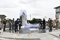 The ROK-U.S. Alliance sculpture is unveiled during a ceremony July 10 at the United States Forces Korea Headquarters building, Camp Humphreys, Republic of Korea.