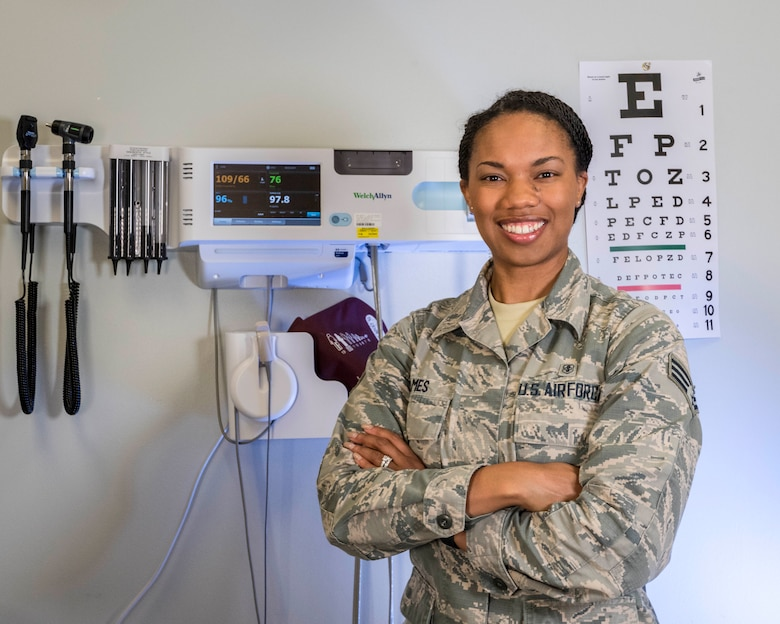 Senior Airman Kaylan James, Flight and Operation Medical Technician assigned to the 913th Aerospace Medicine Squadron, poses in front of medical equipment in an exam room, June 13, 2019 at Little Rock Air Force Base, Arkansas. Senior Airman James' future aspirations are to commission and become an Aeromedical Evacuation Nurse. (U.S. Air Force Reserve photo by Maj. Ashley Walker)