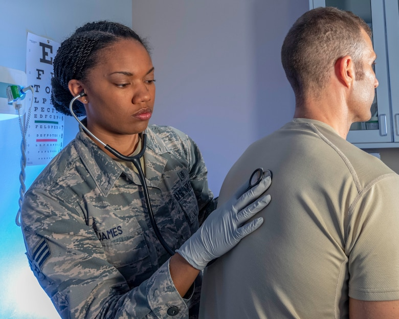 Senior Airman Kaylan James, Flight and Operation Medical Technician assigned to the 913th Aerospace Medicine Squadron, performs a chest and lung examination on a patient, June 13, 2019 at Little Rock Air Force Base, Arkansas. As a FOMT, she is entrusted with creating and managing medical profiles, tracking duty limiting conditions, and mobility restrictions, enabling 913th Airlift Group leadership to effectively manage medical limitations and ensuring a medically ready and deployable force. (U.S. Air Force Reserve photo by Maj. Ashley Walker)