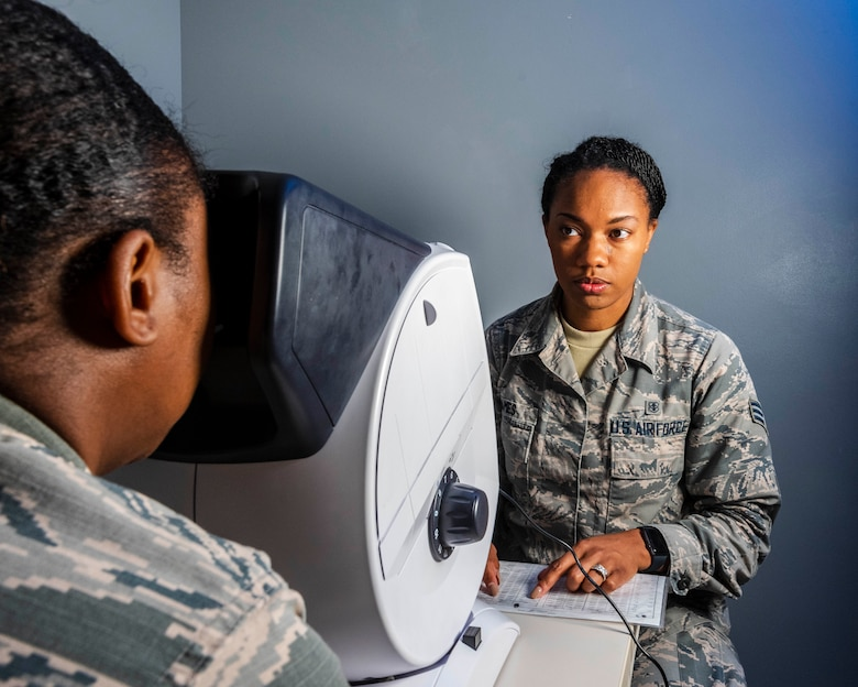 Senior Airman Kaylan James, Flight and Operation Medical Technician assigned to the 913th Aerospace Medicine Squadron, conducts a visual exam on a patient, June 13, 2019 at Little Rock Air Force Base, Arkansas. In addition to primary duties, she teaches basic life support certification to the host active duty population and the tenant reservists, and is a physical training leader who facilitates official testing over drill weekends. (U.S. Air Force Reserve photo by Maj. Ashley Walker)