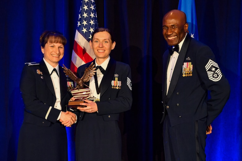Tech. Sgt. Inna Lvova, 50th Comptroller Squadron noncommissioned officer in charge of financial analysis, holds an award for winning 50th Space Wing NCO of the Year award March 8, 2019, Colorado Springs, Colorado. After winning NCO of the year for the 50th Space Wing, Lvova earned the 12 Outstanding Airmen of the Year Award, NCO category, for the Air Force. (U.S. Air Force photo by Kathryn Calvert)